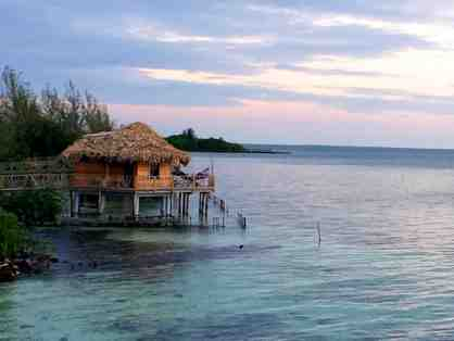 5 Night Stay in an Overwater Bungalow at Private Island Thatch Caye for 2 People