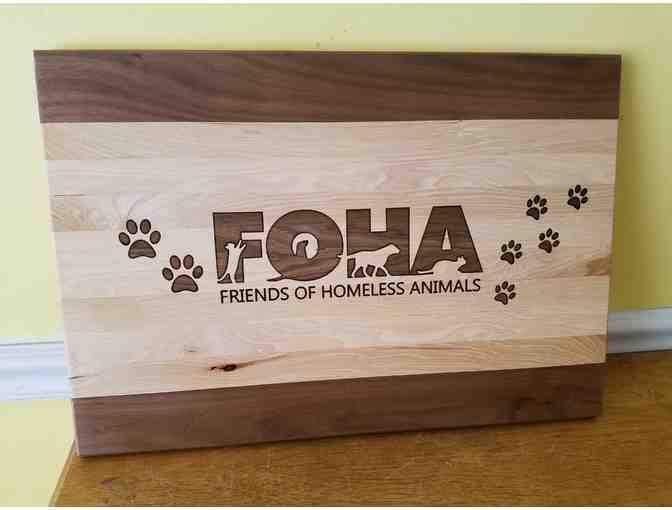 Cutting Board with FOHA logo carving  measures 12'x18'