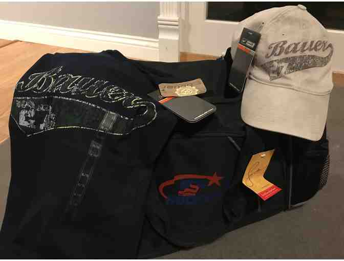 Suter's hockey gym bag, bauer XL shirt and hat