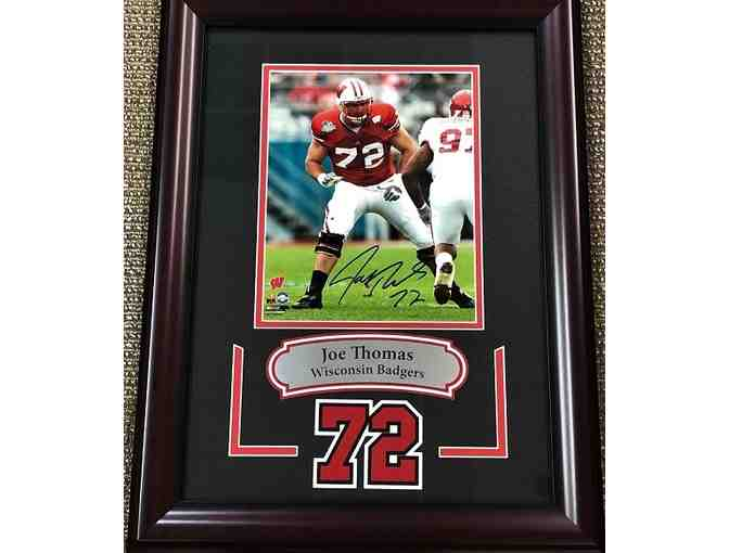 Joe Thomas, 8X10 Wisconsin Badger photo autographed, framed with laser cut double matted