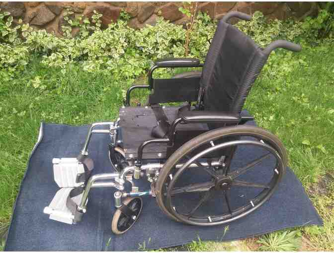 wheel chair folds for car transportation