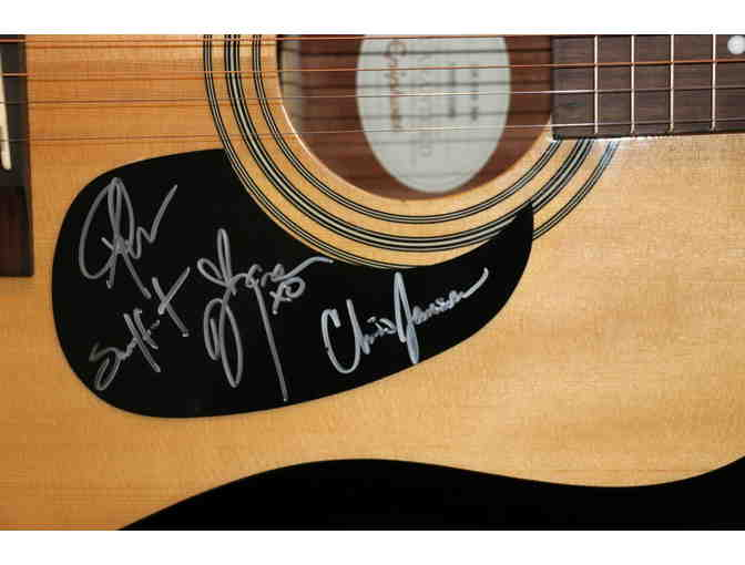 15 in a 30 Tour Autographed Guitar
