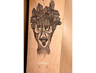 Kevin 'Spanky' Long decorates his own skateboard