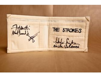 The Strokes one-of-a-kind wallet, decorated and signed by all members