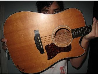 Ed Droste of Grizzly Bear signed Taylor guitar he learned to play on and used fr recording