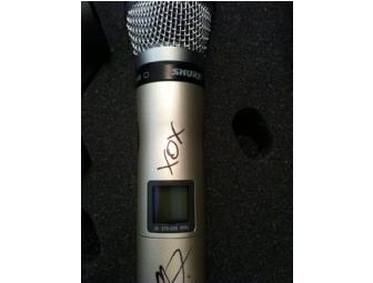 Christina Aguilera sung into and signed her wireless Shure SM86 microphone