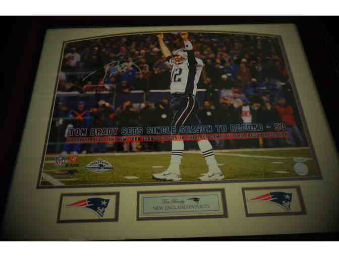 Autographed photo of Tom Brady setting the NFL's Single Season TD record