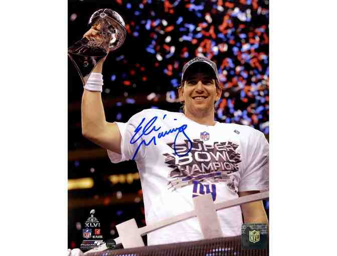 Eli Manning NY Giants autographed Super Bowl Trophy Celebration Framed Photo.
